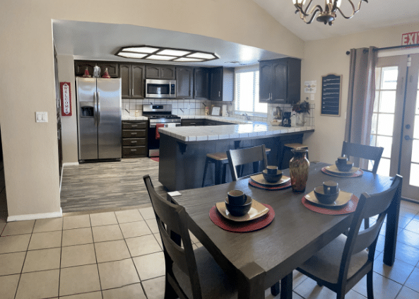 Kitchen and dining area of Rosewood assisted living facility near Fowler, CA