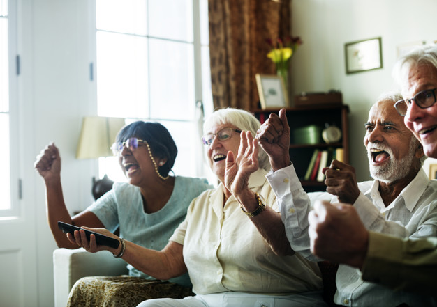 Senior adults watching TV in one of the assisted living facilities in California
