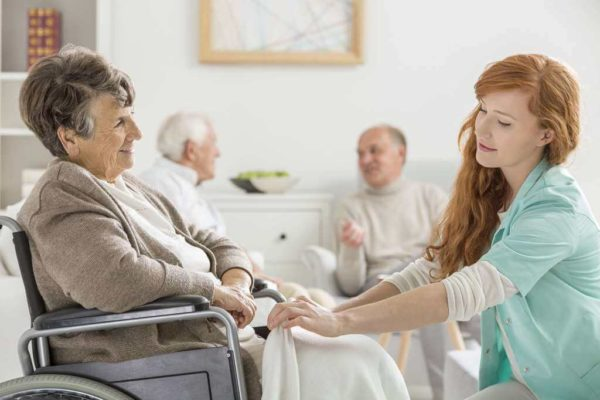 Senior adult talking to a medical staff - cost of assisted living